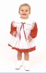 <strong>Baby Sydni in Holiday Pinafore Dress</strong>