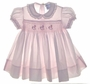 """<img src=""""https://p11.secure.hostingprod.com/@grammies-attic.com/ssl/images/blue-sold-1.gif""""> Carriage Boutiques Pale Pink Smocked Baby Dress with Embroidered Rocking Horses"""
