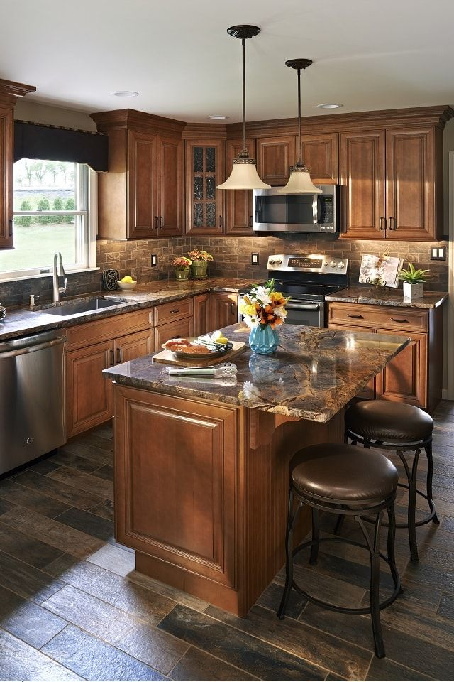 Beautiful kitchen features dark brown stained cabinets ...