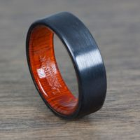 Black Zirconium Ring with a Honduras Redheart Wooden Sleeve by Lashbrook Designs