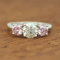 Custom-made Pink Diamond, White Diamond Platinum 3 Stone Ring