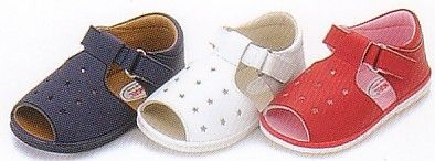Angel sandals with star cut outs, velcro strap and rubber soles.