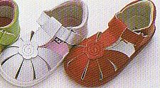 Angel soft leather enclosed t strap sandal with one flower that velcros with rubber sole and padding around the heel.