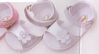Angel soft leather sandals that velcro with a flower on the front.