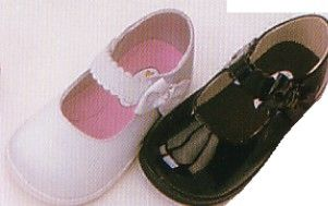 Angel soft mary jane shoes that velcro with a bow on the strap.