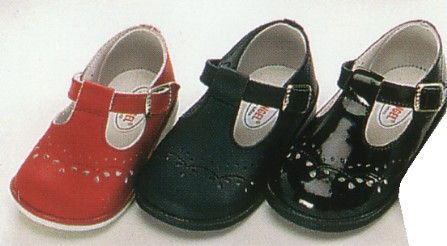 Angel t-strap shoe. Comes black ecru navy pink brown white red and black patent.