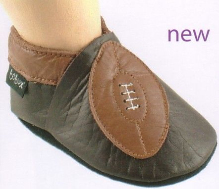 Bobux chocolate with football motif very soft leather shoes. Very comfortable and they stay on. The mothers love them.