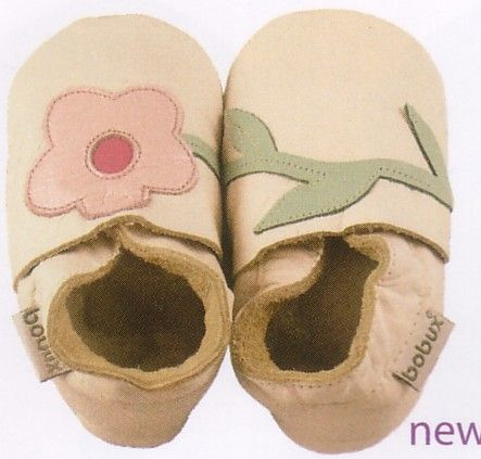 Bobux very soft milk colored leather shoes with flower and stem motif. These shoes are made to stay on.