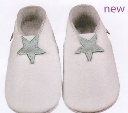 Bobux very soft white leather shoes with blue star motif. These shoes are made to stay on.