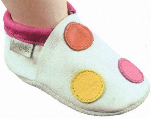 Bobux white leather shoe with orange, yellow, and fuschia dots. Soft leather shoe with a suede sole that stays on the child`s foot.