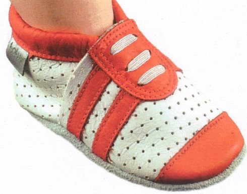 Bobux white perforated sportshoe with orange stripes and tip. Soft leather shoe with a suede sole that stays on the child`s foot