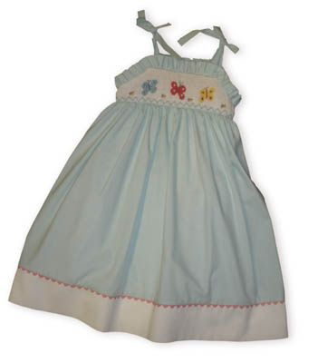 Cupcakes Butterfly Beautiful blue sundress with smocking across the bodice with three butterflies and ties at the shoulders.