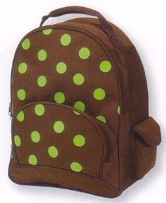 Four Peas Polka Dot big kids backpack features bright lime dots all over the chocolate background. Padded, adjustable straps. Two side pockets have magnetic closures. Front pocket has pencil slots.