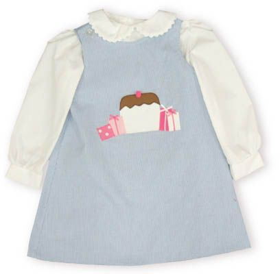 Funtasia Too Birthday Surprise blue jumper with a cupcake and presents on the front and a white blouse with ric rac on the collar. Also reverses to have a picture of a bird on the other side.
