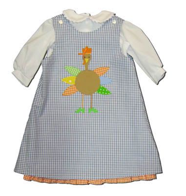 Funtasia Too Don`t Be a Turkey blue and white checked jumper that has a turkey on the front. Says BOO on the reverse side. Festive and matches the boys.