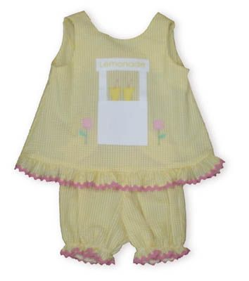 Funtasia Too Lemonade for the Princess yellow and white checked seersucker popover set with a lemonade stand on the shirt and bloomers. Both have ruffles.