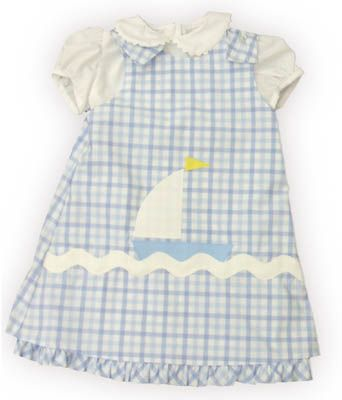 Funtasia Too Out to Sea blue checked jumper with a sailboat on the front and a white blouse with ric rac. It reverses to a bunny rabbit and matches the boys Out to Sea group.