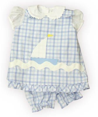 Funtasia Too Out to Sea blue checked popover set with a sailboat on the front and a white blouse with ric rac. It reverses to a bunny rabbit and matches the boys Out to Sea group.