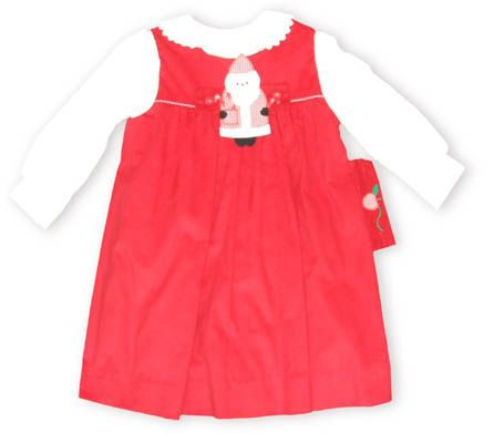 Funtasia Too Santa Land red jumper with a button-on Santa Clause and a white blouse to go underneath. Also comes with an apple button-on.