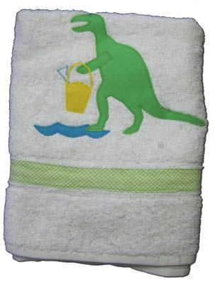 Funtasia Too Tails and Petals towel with a dinosaur on it. Super cute and a must have accessory to go with the swimsuit.