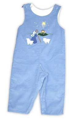 Glorimont Angels We Have Heard on High periwinkle soft corduroy longall with Shepherd and Manger scene appliqued on the front an buttons on the shoulder for needed adjustment.