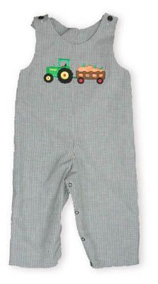 Glorimont Farmer Brown reversible black checked longall with a tractor pulling pumpkins on one side and Santa Claus driving a tractor on the reverse side. So fun and versatile. Also matches the girls.
