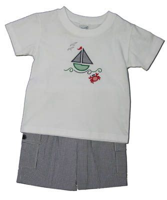Glorimont Sailing the Seven Seas white shirt with a sailboat on the front and matching navy checked shorts. Super comfortable and cute.