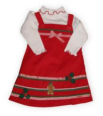 Good Lad Ring the Bells red corduroy jumper with a gingerbread girl and some holly on the front. Also comes with a white blouse. Absolutely a holiday winner!