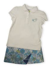 Hartstrings Port of Call white cotton pique polo shirt with a seashell and sand dollar on it. Also comes with matching blue reversible skirt with seashells, sand dollars, and coral on one side and plaid on the other side. Fun and great for many occasions.