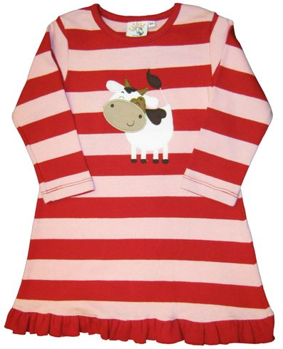 Luigi Cow on a soft pink and red dress in Peruvian cotton with a ruffle hem.