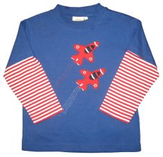 Luigi Fight jets on a soft blue knit shirt with red stripe sleeves.
