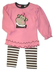 Luigi Monk the Monkey on a soft long sleeve bubblegum pink top with ruffles with matching stripe leggings in Peruvian cotton.
