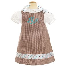 Remember Nguyen Candace chocolate check jumper with ribbons on the shoulder. Blouse not included.