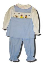 Remember Nguyen girls clothes Snow White blue popover set with a snow white scene smocked on the top. Super cute. Blouse not included.