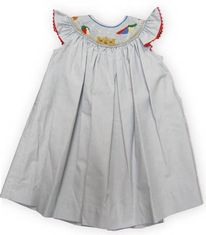 Royal Child Beach Princess sweet bishop dress with angel wing sleeves and a beach scene in the smocking. Matches the boys.