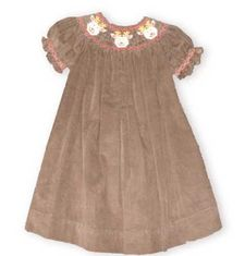 Royal Child Three Deer fine corduroy bishop dress in chocolate brown has Rudolf and his two best friends smiling around the smocked neck.