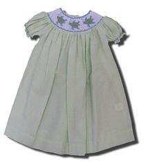 Royal Child Trotting Turtle green checked bishop dress with three turtles in the smocking. Matches the boys.