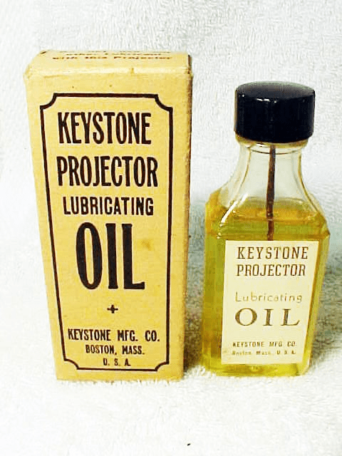 Keystone Projector Lubrcating Oil in antique glass bottle