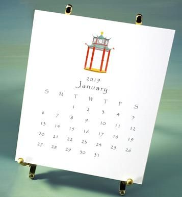 2019 favorites desktop calendar with brass easel, packaged in box with ribbon and charm
