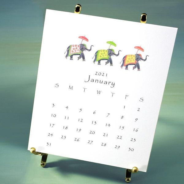 2021 favorites desktop calendar with brass easel, packaged in box with ribbon and charm