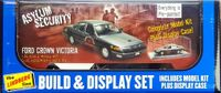 "Lindberg 1997 Ford Crown Victoria ""Asylum Security"" 4 Door Sedan Pre-Painted with Chrome Base Display Case"