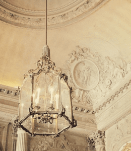 French White Architecture and Silver Chandelier