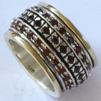 Designer ring silver and gold set with garnets spinner ring