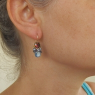 Earrings burgundy Swarovski crystal  on copper.   Natural wild Pearls. Blue Kyanite  dangles down gently.