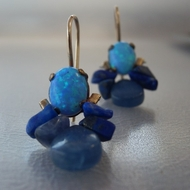 Earrings made of beautiful Lab opal set on a copper basis
