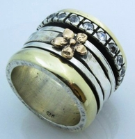 Adorable Cubic zirconia ring flower spinner ring