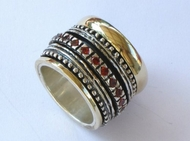 Garnets ring spinning silver & gold ring