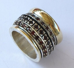 Garnets spinner ring silver and gold rings