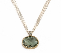 Green amethyst pendant on a silver and gold chain