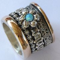 Blue opal on silver and gold ring